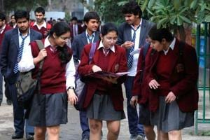 Class XII students coming out after appearing for their English language paper during Central Board of School Education (CBSE) examinations.