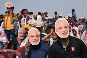 BJP supporters wear masks of Prime Minister Narendra Modi during an election rally at Phulbari in Meghalaya's West Garo Hills recently.