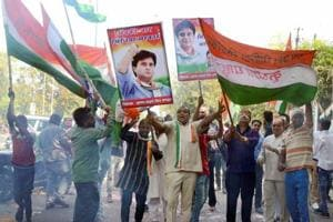 Congress workers celebrate the win in Kolaras and Mungaoli assembly by-elections at the party's headquarters in Bhopal on Wednesday.