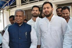 Rashtriya Janata Dal leader Tejashwi Yadav with former Bihar chief minister and Hindustani Awam Morcha (Secular) leader Jitan Ram Manjhi leave after attending a meeting in Patna.