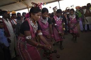 Tribals perform to traditional songs during Bhagoria celebrations, in Jhabua Madhya Pradesh.