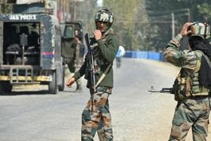 Paramilitary troopers stand guard after a gunfight with militants at Hajin village in Kashmir