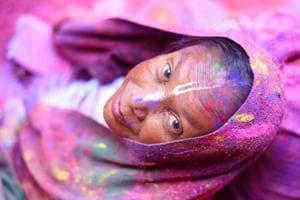 Photos: A riot of colour as Vrindavan widows celebrate Holi in Mathura
