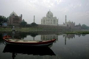 The Taj Mahal as seen from the banks of the river Yamuna, in Agra.