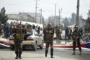 Afghan security personnel arrive at a site after a car bomb targeting foreign troops in Kabul on March 2, 2018.