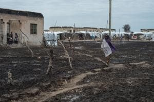 In this file photo taken on July 29, 2017 a woman walks through the internally displaced Peoples' camp of Rann, northeast of Nigeria, close to the Cameroonian border.
