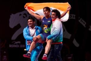 Navjot Kaur celebrates with coaches after winning gold in the Asian Wrestling Championships inBishkek, Kyrgyzstan, on Friday.