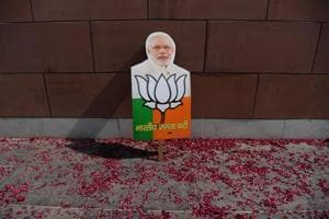 A placard with the image of Prime Minister Narendra Modi is pictured near a rally of supporters of the Bharatiya Janata Party (BJP) as they celebrate following state election victories, outside the BJP headquarters in New Delhi on March 3.