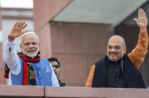 Prime Minister Narendra Modi and BJP president Amit Shah wave as they arrive to address party workers after their victory in Tripura elections at party headquarters in New Delhi on Saturday.