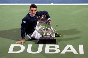 Roberto Bautista Agut denies Lucas Pouille top-10 spot with title win...