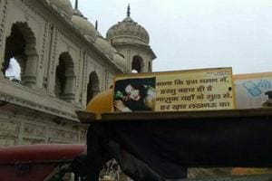 A couplet written on an e-rickshaw as it moves in front of Imambada in Lucknow.