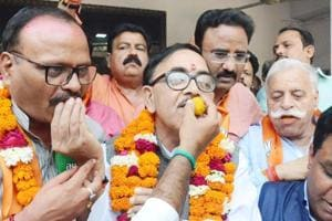 BJP leaders celebrating party's Tripura victory at party office on Saturday.