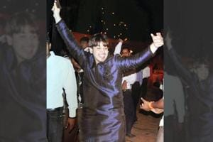 Akash Yadav dancing with a gun in his hand at the wedding of his brother in 2013 in Gurgaon.