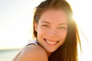 A smile intended as a reward, to reinforce behaviour, appear to physically buffer recipients against stress.