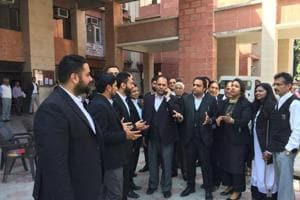 Protesting lawyers at the Chandigarh district courts in Sector 43 on Monday.