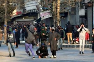 Protesters throw stones at security forces during a demonstration against the killing of three civilians allegedly in Army firing in Shopian district on January 27.