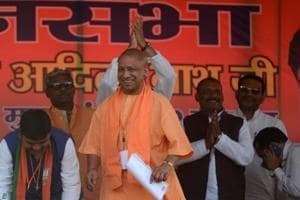 Chief minister of Uttar Pradesh, Yogi Adityanath looks on towards a crowd during a public meeting for BJP