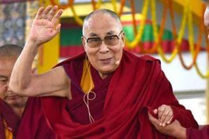 Tibetan spiritual leader the Dalai Lama greets schools students at an event in Bodhgaya.