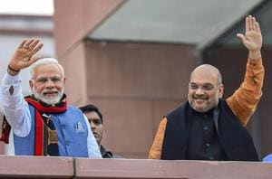 Prime Minister Narendra Modi and BJP president Amit Shah wave as they arrive to address BJP party workers after their victory in Northeast assembly elections in New Delhi on Saturday.