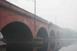Composed of a series of six 70-feet-wide arches, the  red-brick railway bridge looks like a Roman aqueduct.