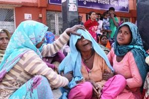 Relatives console the mother of Ajay Jatav at the community health centre at Bhiwadi in Alwar district on Tuesday.