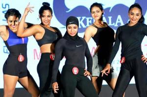 Burkini-clad Majizia Bhanu with other participants at a bodybuilding competition in Kochi.