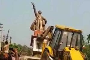 A statue of Vladimir Lenin being demolished at Belonia town in south Tripura on Monday.