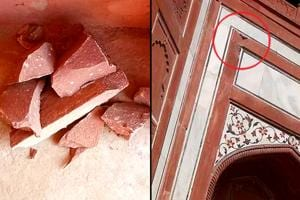 Red sandstone pieces which fell from a corner of the Taj Mahal's royal gate.