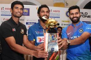 Captains Dinesh Chandimal (C) of Sri Lanka, Rohit Sharma (R) of India and Mahmudullah Riyad (L) of Bangladesh pose behind the Nidahas tri-nation Twenty20 tournament series trophy in Colombo on Sunday.
