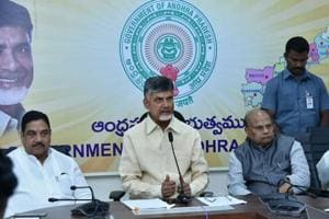 Andhra chief minister Chandrababu Naidu (centre) addresses the media with cabinet colleagues late on Wednesday night.
