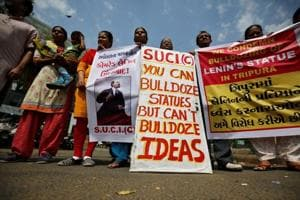 Activists of Socialist Unity Centre of India (SUCI) hold placards and shout anti-government slogans during a protest against what they say was the demolition of a statue of Vladimir Lenin in Tripura.