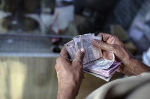 Rupee trades flat after touching one-week high of 64.88 against US...