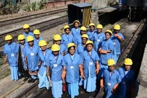 Newly trained members of an all-women coach maintenance team of the Indian Railways at the pit lines in Guwahati.