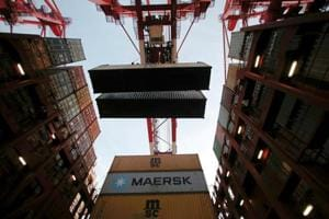 One crew member dies, four missing after Maersk Line vessel catches...