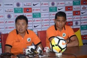 Asked about his future, NEROCAFC coach Gift Raikhan (L) paused before telling the media he would have to consult his wife about it.