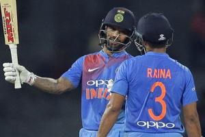 Shikhar Dhawan (L)celebrates after scoring his fifty during the Nidahas Trophy 2018 encounter between India and Bangladesh in Colombo on Thursday.