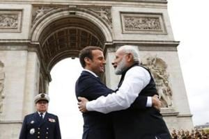 Prime Minister Narendra Modi (L) says goodbye to French President Emmanuel Macron after a ceremony at the Arc de Triomphe on the last leg of his four-nation visit in Paris, on June 3, 2017.