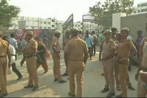 Policemen outside the gate of Meenakshi Academy of Higher Education and Research in Chennai on Friday.
