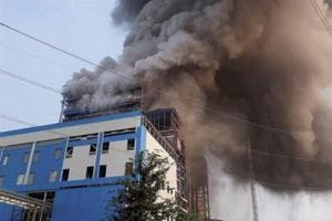 A file pictures shows smoke billowing out of NTPC's Unchahar power plant where a blast took place in a boiler in Uttar Pradesh's Rae Bareli district on November 1, 2017.
