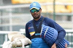 Sri Lankan cricketer Upul Tharanga walks with his equipment during a practice session at the R.Premadasa Stadium in Colombo on Friday.