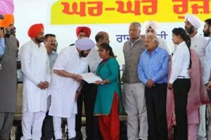 Punjab CM handing over appointment letter to a woman at a job fair in Mohali.