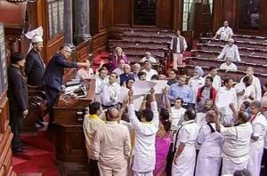 Opposition members protest in the well of the Rajya Sabha in New Delhi during the ongoing Budget session.