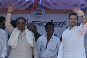 Congress president Rahul Gandhi and Karnataka chief minister Siddaramaiah during a public meeting in Jamakhandi, Karnataka on February 25, 2018.