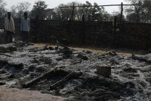 The burnt remains of a semi-permanent forest post at Lathawar that suspected Maoists torched on March 2.