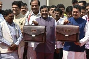 State finance minister Sudhir Mungantiwar and minister for state for finance Deepak Kesarkar arrive at Vidhan Bhavan, Mumbai, on Friday afternoon to present the state budget.
