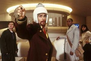 Sam Rockwell (centre), Yasiin Bey (on right), Zooey Deschanel (far right), and Martin Freeman (left) in a still from the movie, The Hitchhiker's Guide to the Galaxy (2005).