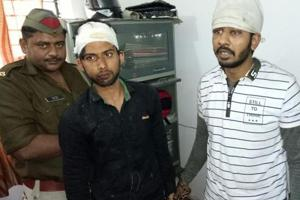 Police arrested Minhaz (left) and Saif (right) for allegedly attempting to rob a senior citizen in Noida using fake pistols. Police are hunting for their two other accomplices.