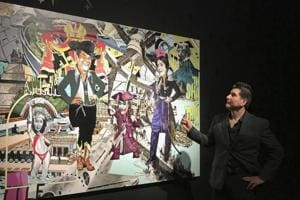 Artist Claudio Dicochea explains one of the paintings in his Acid Baroque exhibit on display at the Scottsdale Museum of Contemporary Art in Scottsdale, Arizona.