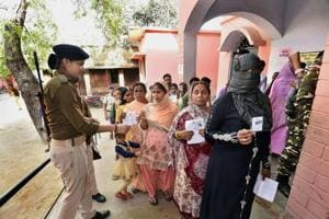 People stand in queue to cast vote for the Jehanabad Assembly bypoll in Bihar on Sunday.