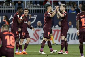 Barcelona stroll past Malaga without new father Lionel Messi in La...